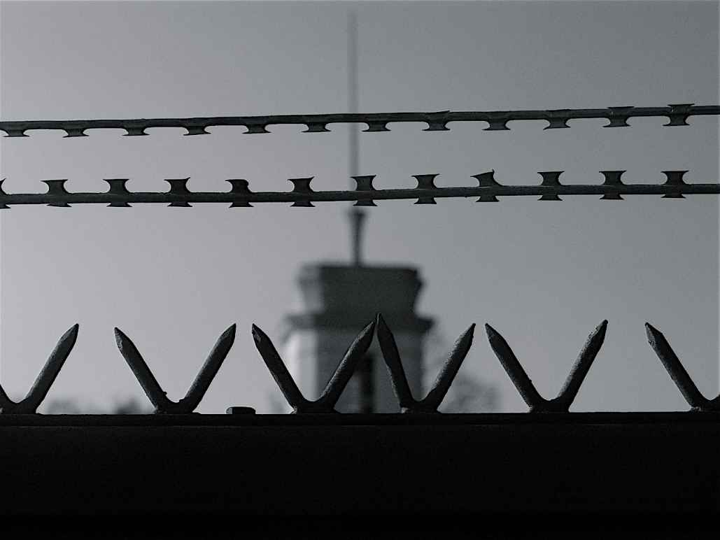 A black and white image of a prison fence.